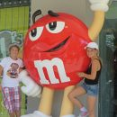 Two young children standing next to m&m