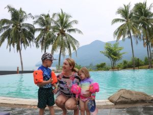 woman by the pool with her children