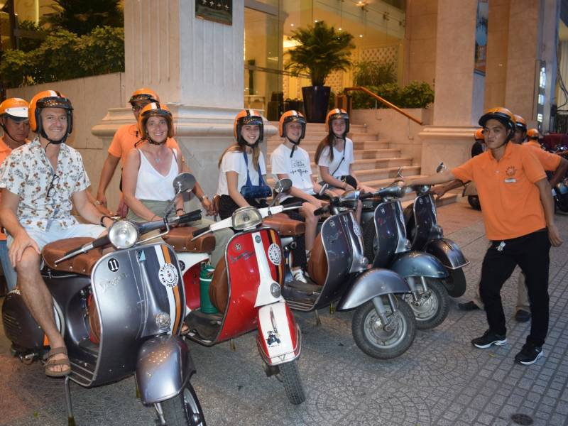 group of people on mopeds with guides