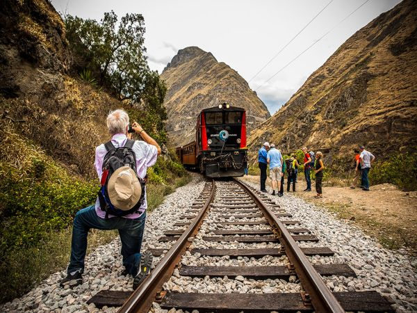 locals and tourists on train tracks