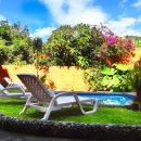 Pool and sunloungers at hotel in Banos, Ecuador