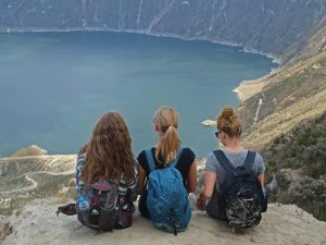 Tourists looking into crater lake in Quilotoa, Ecuador