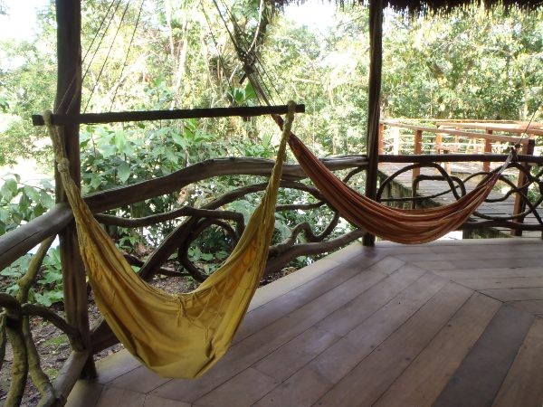 Hammocks on the porch in Amazon lodge, Ecuador