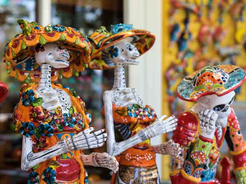skeletons at mexicos day of the dead festival
