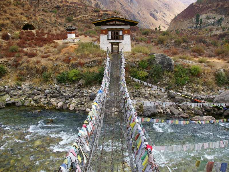 Bhutan traditional bridge crossing a river at height