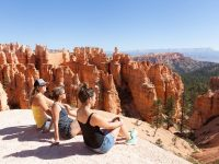 Three girls overlooking red rock formations in Bryce National Park, USA