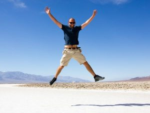 man jumping in death valley
