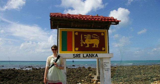 person in front of sri lanka flag