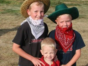 Three boys dressed as cowboys in Bryce National Park, USA