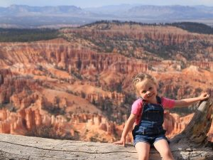Girl with backdrop of Bryce National Park, USA