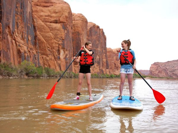Girls paddleboarding in Moab, USA