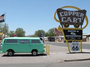 Campervan next to Route 66 sign street