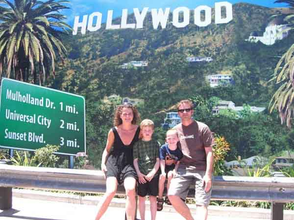 Family sat under hollywood sign