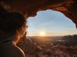 woman watching sunset over national park
