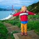 Young girl in front of golden gate