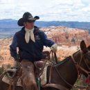 Cowboy on horse in Bryce National Park, USA