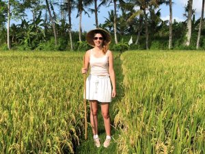 woman stood in rice fields with hat