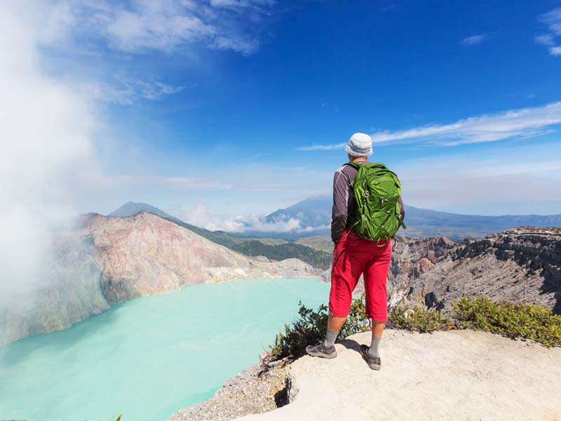 man looking at view of Ijen Plataeu