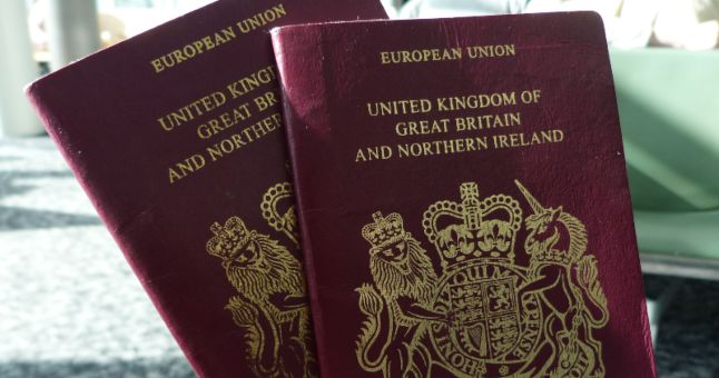 person holding two British passports