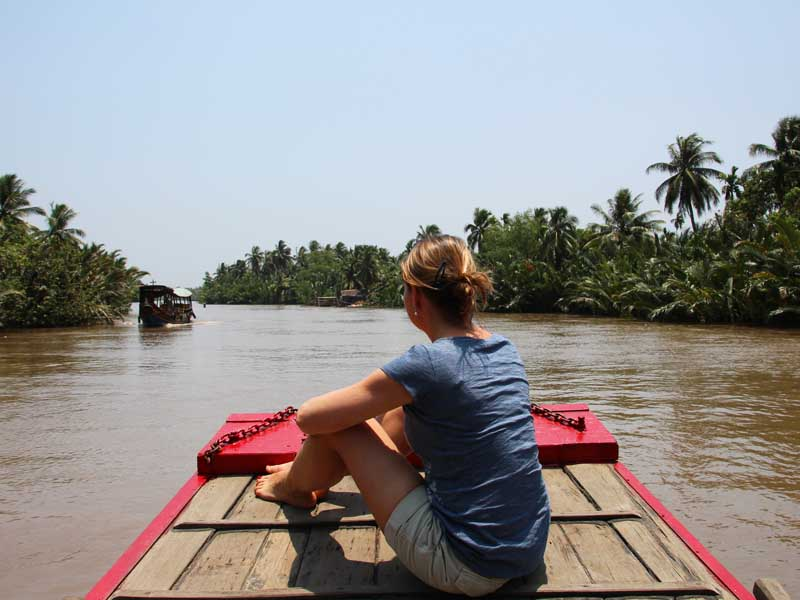 woman on boat on the mekong