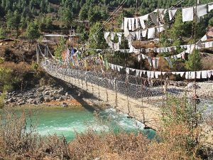 Suspension bridge over the river in Bumthang, Central Bhutan