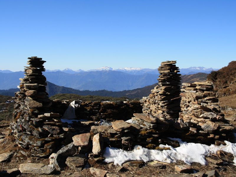 Mountains with rocks piled in front and snow