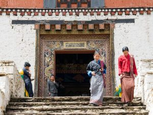 Locals wearing traditional outfits in Bhutan