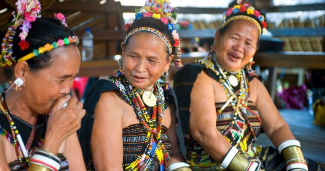 3 women in traditional Borneo dress