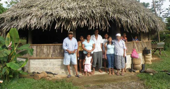 costan rica family outside hut