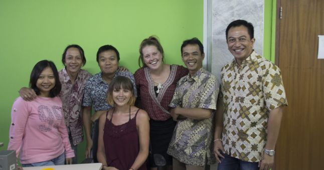 Indonesian people in office with tourists