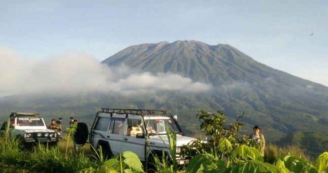 jeep in front of volcano