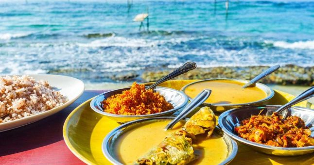 plates of sri lankan food by the sea