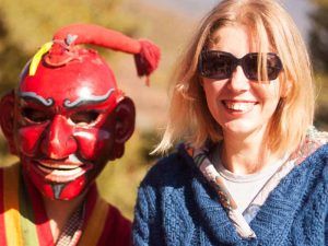 bhutan travel specialist kate at a tsechu festival