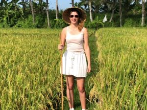 woman in rice field with traditional hat