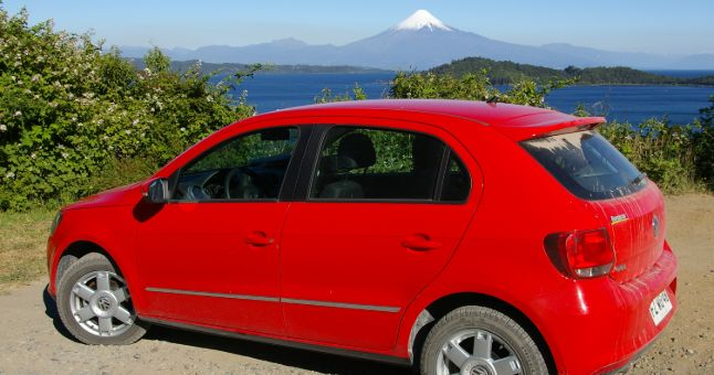 red car with mountain in background