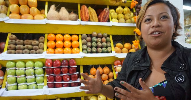 local guide talking about fruit in shop