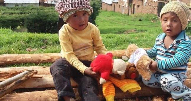 children playing with toys in Peru