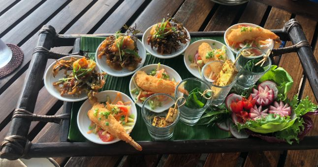 tray of small plates of thai food
