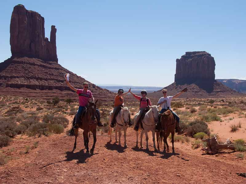 family riding horses in the USA