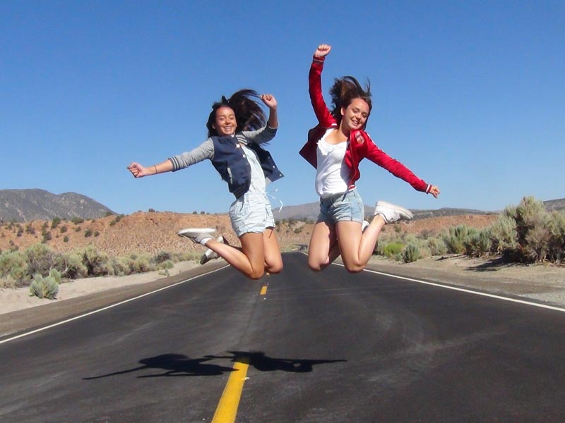 girls jumping in the air on route 66