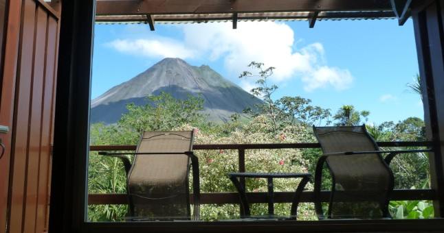 chairs on balcony overlooking volcano