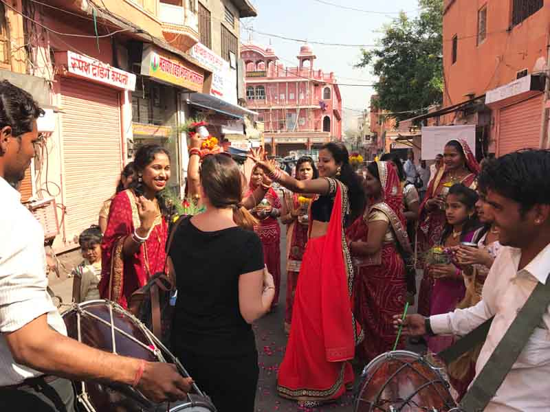 traveller dancing with the locals in India