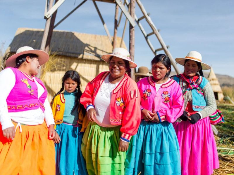 Women in traditional dress on Lake Titicaca