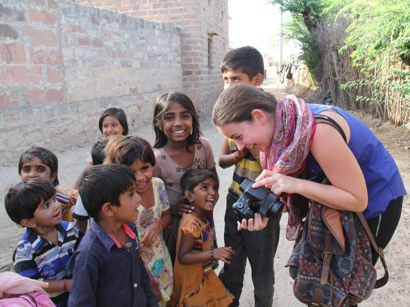 women taking pictures of children in india