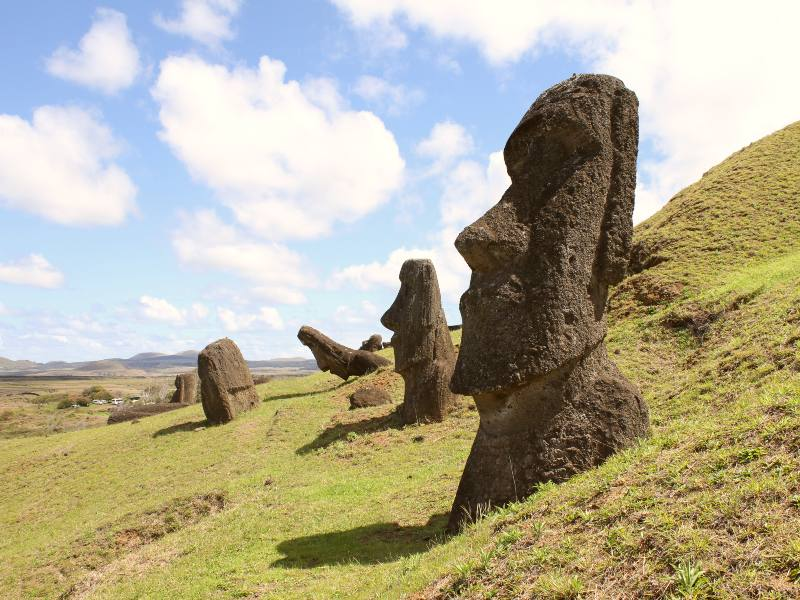 carved stone heads on a hillside