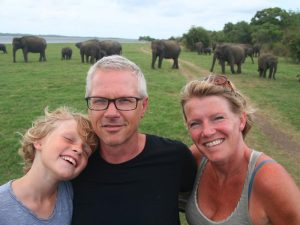 family on an elephant safari in sri lanka