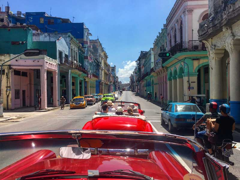 classic car in havana with colourful streets