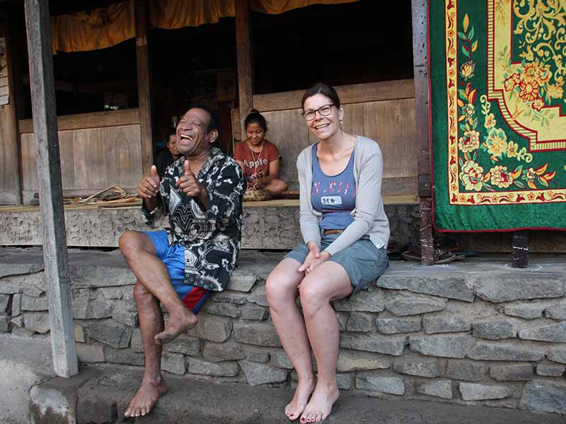woman sitting with local man in indonesia