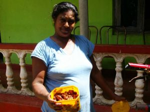 Local woman with tamarind in Digana