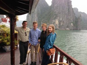 Family on a junk boat in Bai Tu Long Bay